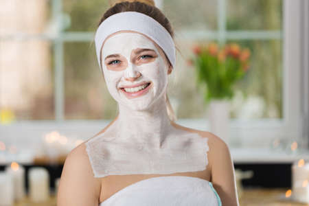 Woman during spa treatment with mask on her face Stock Photo