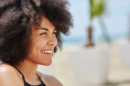 Young happy afro american woman looking away