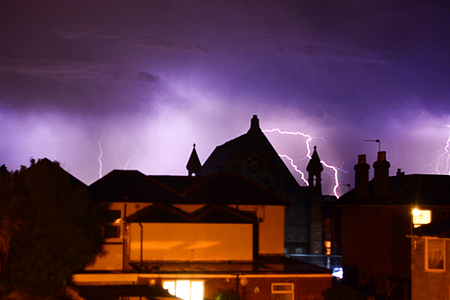 Lightning over rootops at Sandown on the Isle of Wight.