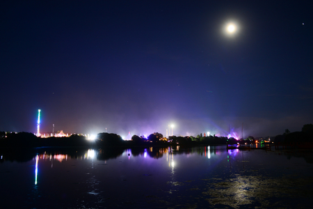 Isle of Wight Festival Lights and Full Moon Reflecting from the River Medina.