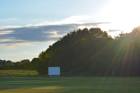 Cricket Ground and Scorecard at Sunset