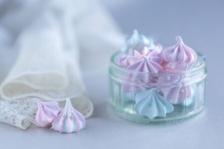 Colored Meringue candies in a glass container with bright background Stok Fotoğraf
