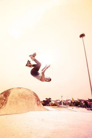 Young man doing inline skating tricks at a skate park