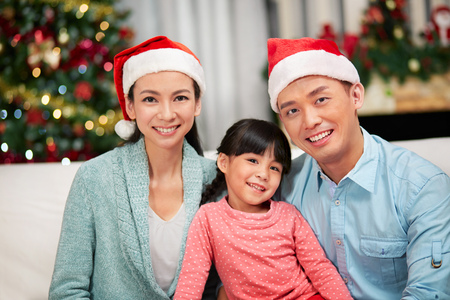 outerwear: Portrait of happy family for Christmas time