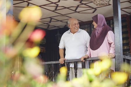 malay village: Senior couple looking at each other on veranda