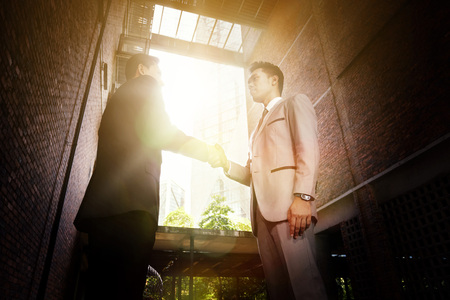 superiors: Businessmen shaking hands