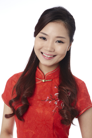toothy: Young woman in traditional Cheongsam smiling happily LANG_EVOIMAGES