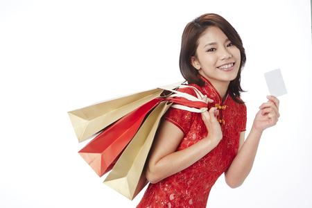 toothy: Joyful young woman shopping for Chinese New Year LANG_EVOIMAGES