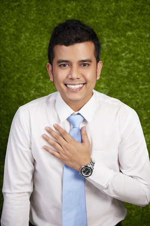 well dressed: Businessman making a welcoming gesture