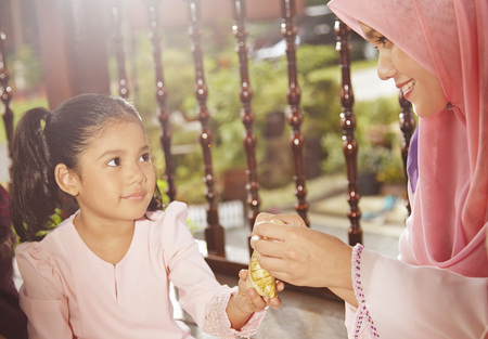 malay village: Family eating together during Hari raya LANG_EVOIMAGES