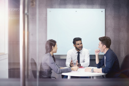 round chairs: Business people having discussion in meeting room