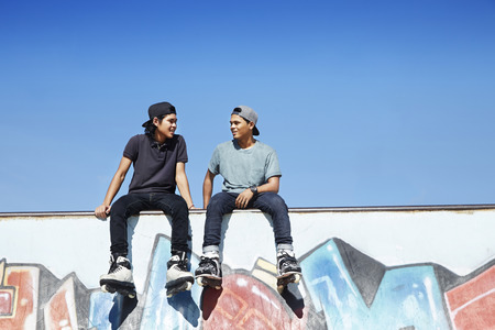 Young men sitting at a skate park