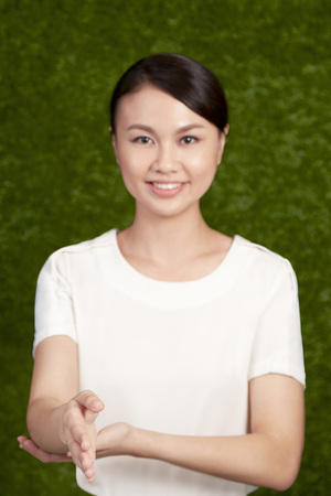 Businesswoman offering hand in greeting LANG_EVOIMAGES
