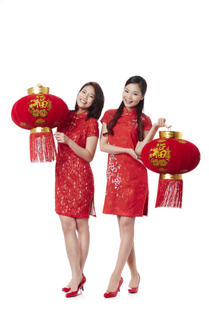 lucky charm: Young women holding Chinese lanterns