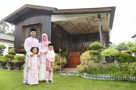 well dressed: Family portrait on Hari raya LANG_EVOIMAGES
