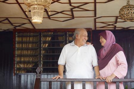 malay village: Senior couple smiling at each other on veranda