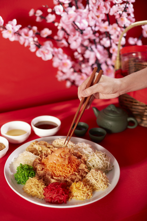longevity: Yeesang or Prosperity Toss dish (A popular festive dish during Chinese New Year of raw vegetables and salmon slices) LANG_EVOIMAGES