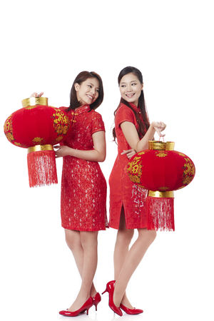 Young women celebrating Chinese new year with Chinese lanterns LANG_EVOIMAGES
