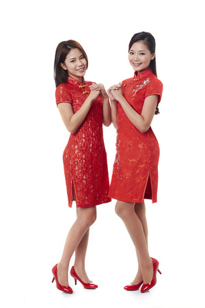 Young women makes a gesture of greeting and good wishes LANG_EVOIMAGES