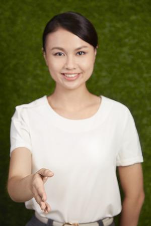 Businesswoman extending hand to shake hands