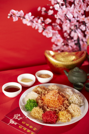 sesame cracker: Yeesang or Prosperity Toss dish (A popular festive dish during Chinese New Year of raw vegetables and salmon slices) LANG_EVOIMAGES