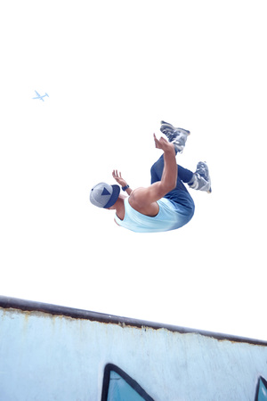 Young man doing inline skating tricks at a skate park