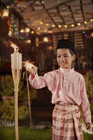 traditional house: Young boy play with sparklers