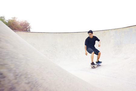 Young man skateboarding at a skate park
