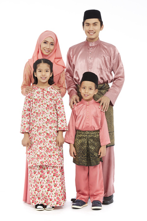 Portrait of a Malay family of four in traditional Malay clothes