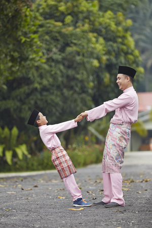 Father and son playing outdoor during Hari raya LANG_EVOIMAGES
