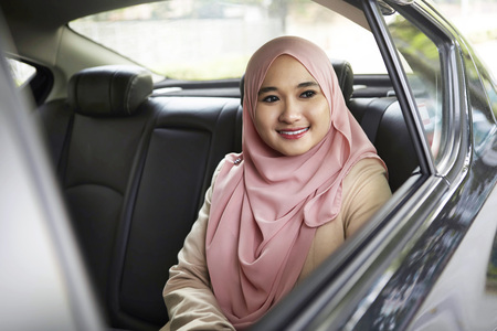 transportation: Smiling young Malay woman in a car