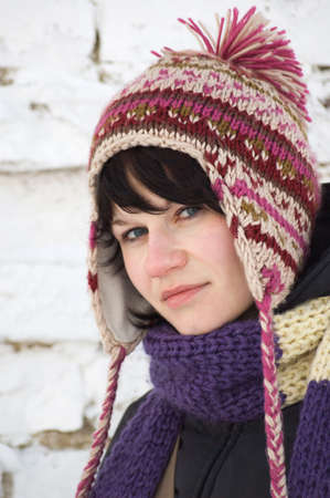 Winter Girl in hat with pompon photo