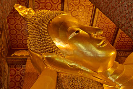 Lying Golden Buddha in Wat Pho of Bangkok photo