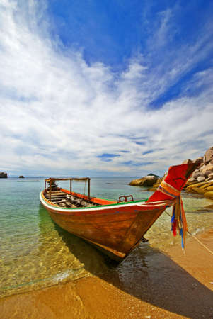 Thai Longtail boat at Koh Tao beach photo