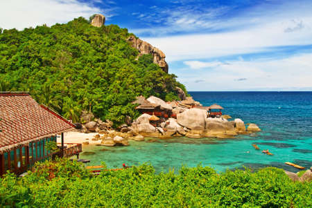 untitled key: Secluded Bay with Turquoise Waters and Lush green mountain Stock Photo