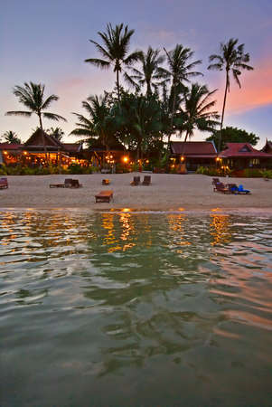 Exotic Tropical Resort at Colorful Sunset photo