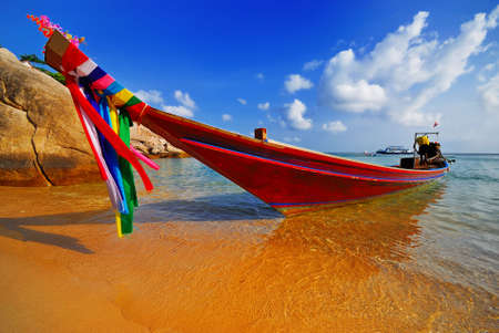 Traditional Thai Longtail boat on the beach Stock Photo - 2612971