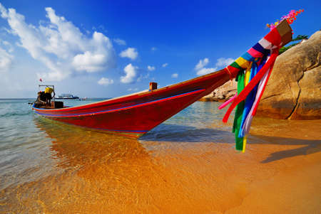 Traditional Thai Longtail boat on the beach photo