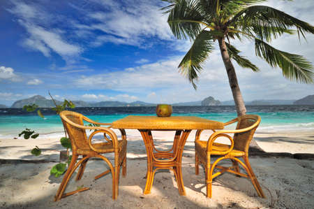caribbean drink: Fresh Coconut juice at the seaside table