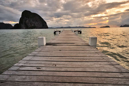 Sunset Jetty into the sea photo