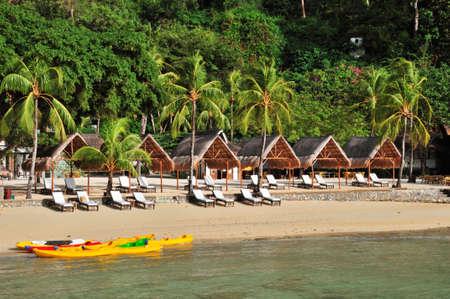 Luxury Beach with Huts and Kayaks Stock Photo - 4350071