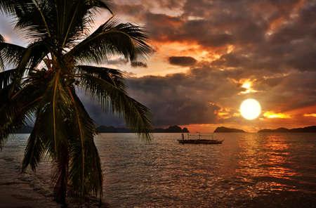 Paradise Tropical Sunset Seaside Scene photo