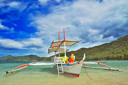 outrigger: outrigger boat in a beautiful lagoon Stock Photo