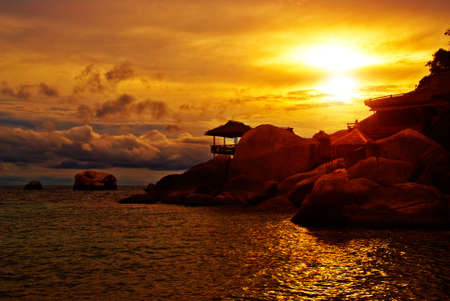 Sunset Villa Standing in Rocks on the Sea Edge Stock Photo - 5381770