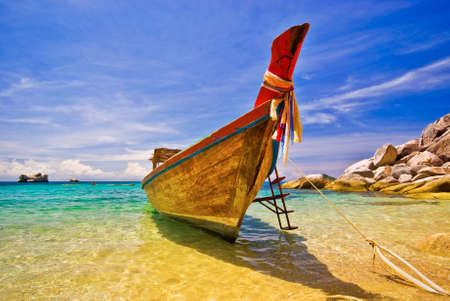 Longtail Boat Anchored in idyllic settings photo