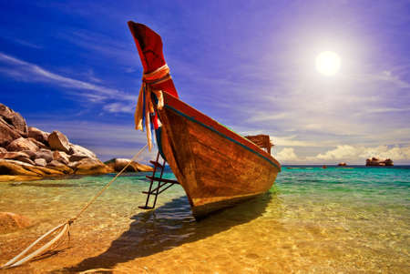 longtail: Traditional Thai Longtail Boat at Sunset