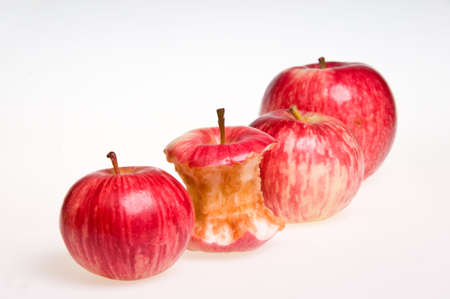 Bit of Apple in a Row of Juicy Apples photo