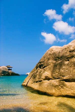 A gorgeous seaside view with blue skies, majestic rocks and clear water Stock Photo - 5686748