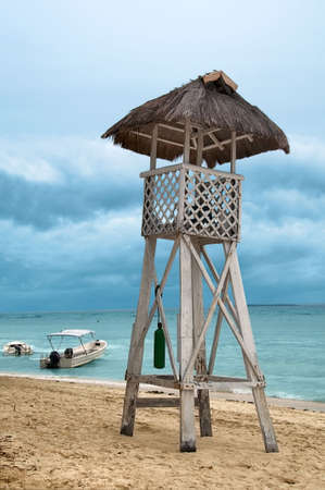 wooden life guard tower on  a stormy beach photo