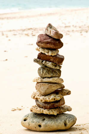 stones stacked on the beach photo